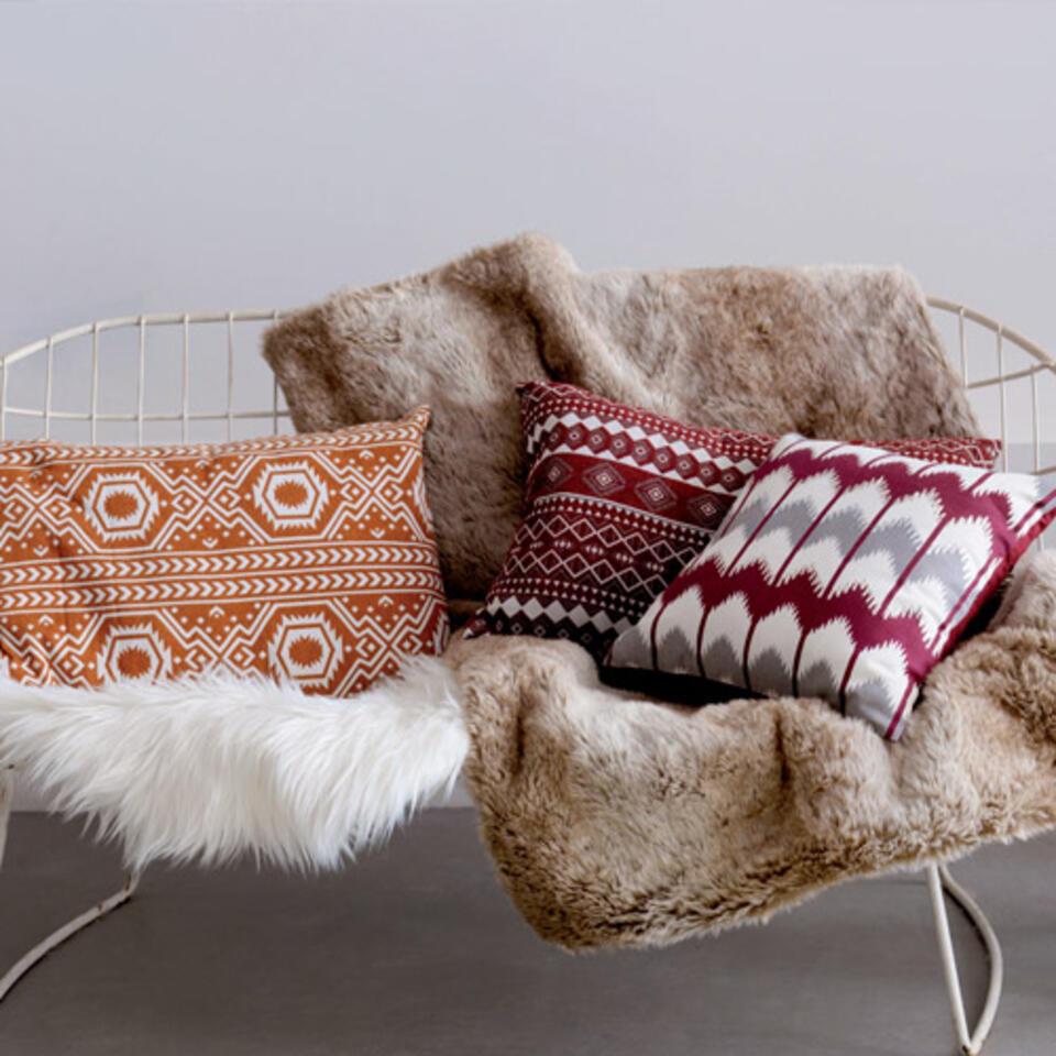 plaid e cuscini accoglienti