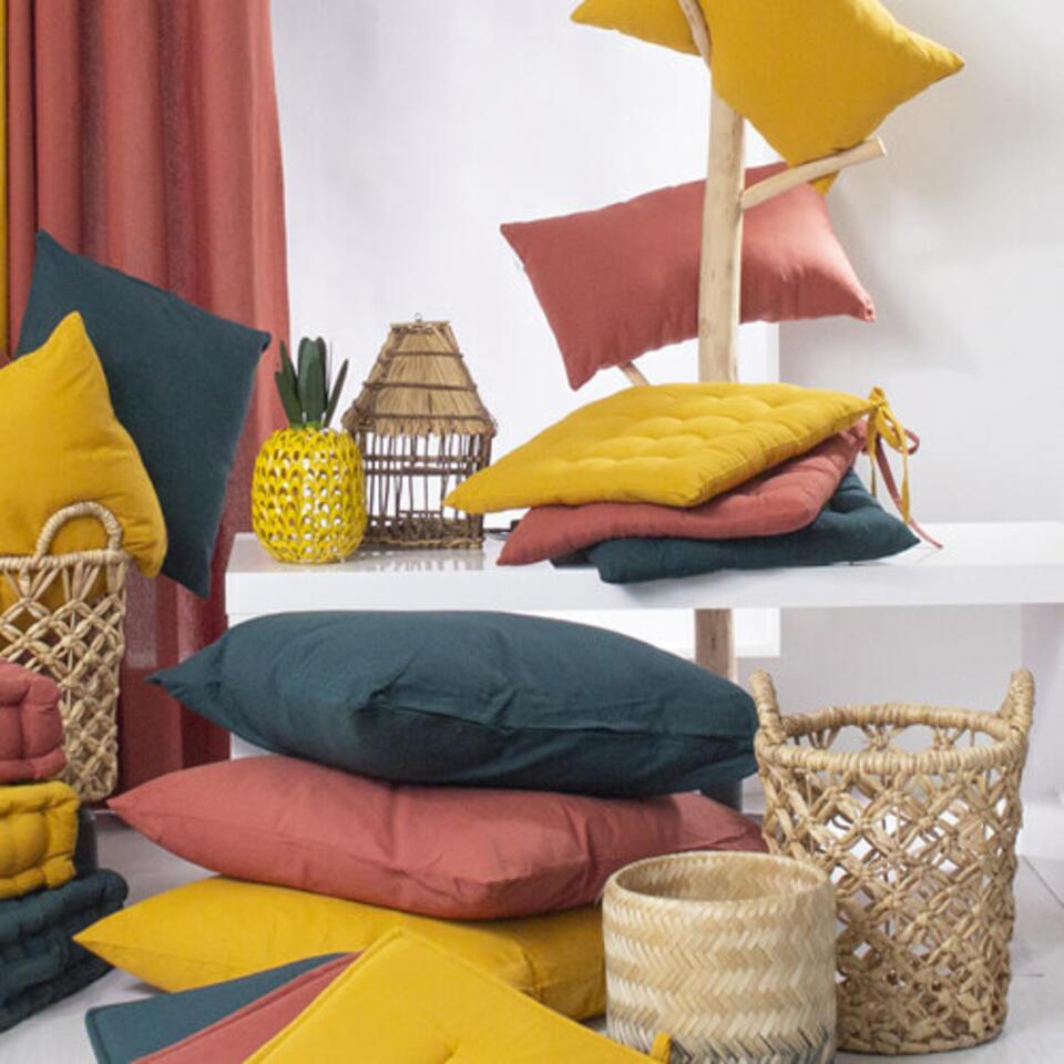 coussins couleur terracotta et jaune épicé