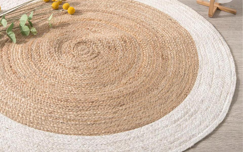 tappeto rotondo in iuta con contorno biancois rond en jute avec contours blanco