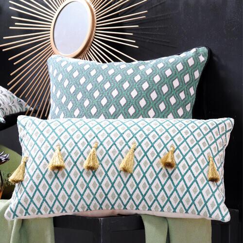 cuscino verde con pompon