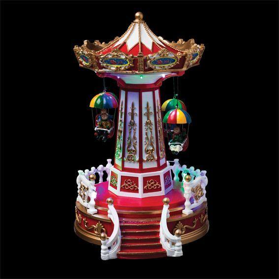 Idee Deco noel lumineux : Carrousel de Noël lumineux Chaises volantes - Village de Noël ...