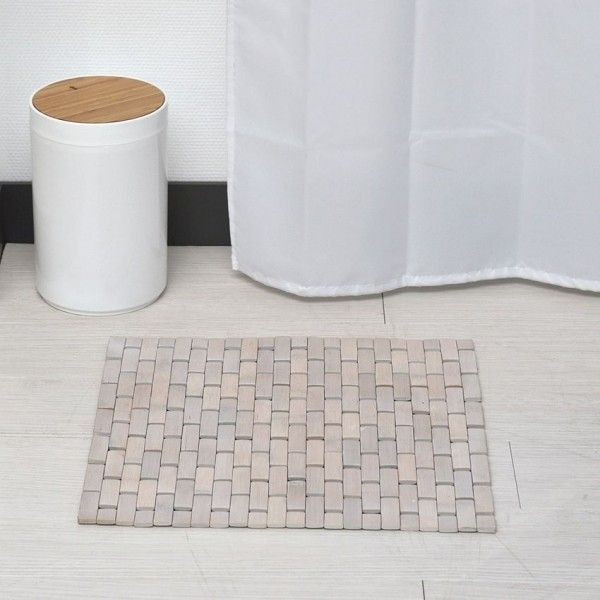 Tapis salle de bain tapis en bambou tapis de bain eminza for Tapis de bain en bois de bambou