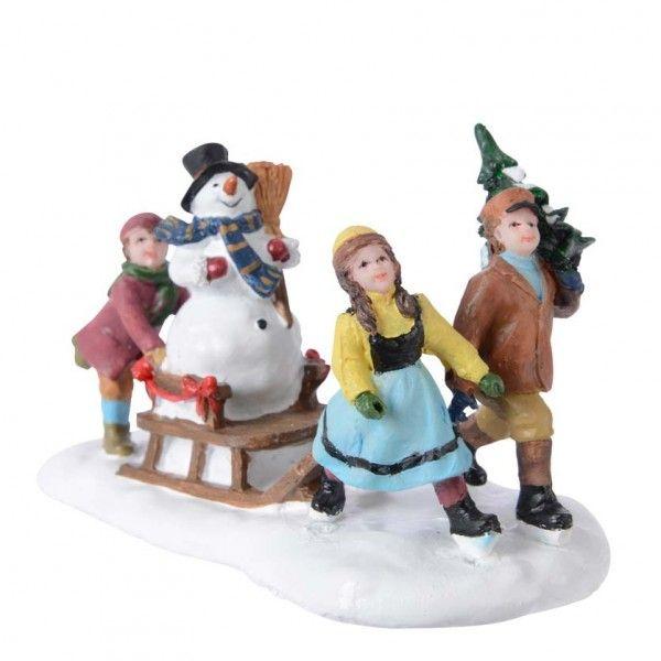 Figurine enfant et luge d 39 hiver village de noel eminza - Jeux pere noel luge ...